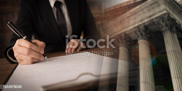 istock lawyer attorney working 1044578200
