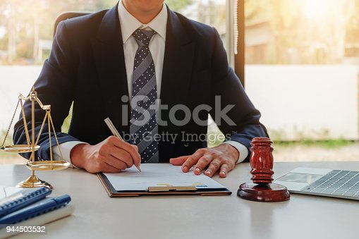 istock Lawyer concept, Legal professions with legal devices  gavel and lawyer brand on desk in office. 944503532