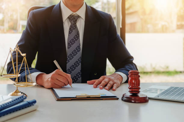 Lawyer concept, Legal professions with legal devices  gavel and lawyer brand on desk in office. Lawyer concept, Legal professions with legal devices  gavel and lawyer brand on desk in office. lawsuit stock pictures, royalty-free photos & images