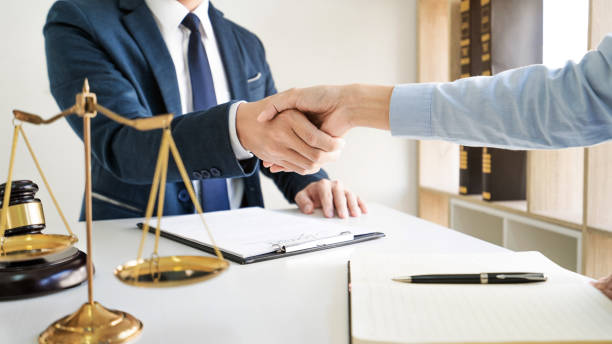 lawyer consultant with client discussing about contract management in court room. stock photo