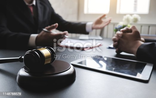 istock lawyer consultation with his client, in the office of the attorney. 1148788529