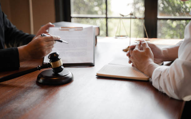 lawyer consulting with client discussing about contract. stock photo