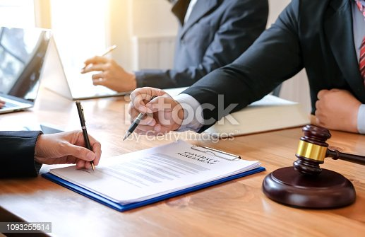 1050485096 istock photo Lawyer give his customers signed a contract in the document. Consulting in regard to the various contracts 1093255514