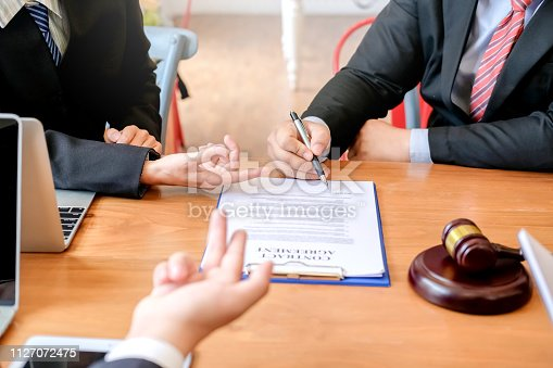 1050485096 istock photo Lawyer give his customers signed a contract in the document. Consulting in regard to the various contracts 1127072475