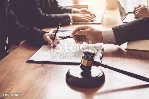 1050485096 istock photo Lawyer give his customers signed a contract in the document. Consulting in regard to the various contracts 1127072526