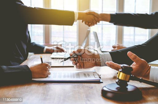 836113188 istock photo Lawyer give his customers signed a contract in the document. Consulting in regard to the various contracts 1130455910