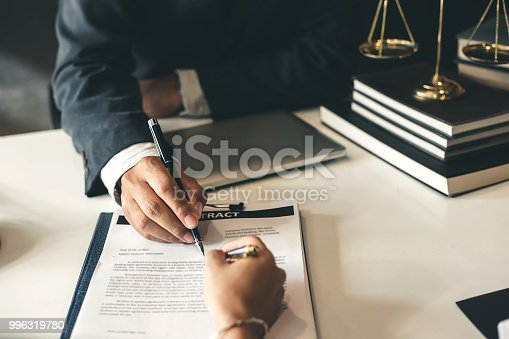 istock Lawyer give his customers signed a contract in the document. Consulting in regard to the various contracts 996319780