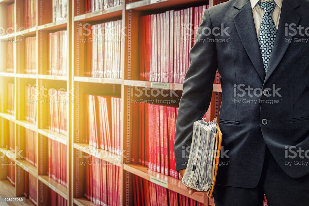 lawyer holding files in the law library at the university stock photo