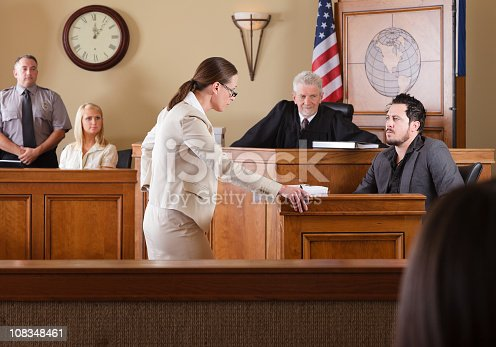 A lawyer questioning a witness in front of the judge in a courtroom.  [url=search/lightbox/8668962] [img]http://richlegg.com/istock/banners/courtroom_banner.jpg[/img][/url] [b][url=search/lightbox/8668962]Click Here to see my other Courtroom images[/url][/b]  [url=search/lightbox/5631688] [img]http://richlegg.com/istock/banners/ron_banner.jpg[/img][/url] [b][url=search/lightbox/5631688]Click HERE to see more of this model[/url][/b]  [url=search/lightbox/8717995] [img]http://richlegg.com/istock/banners/melinda_banner.jpg[/img][/url] [b][url=search/lightbox/8717995]Click Here to see more of this model[/url][/b]