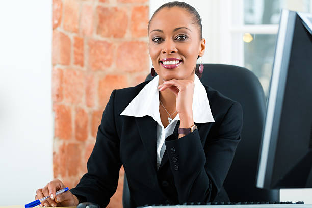 Lawyer in office sitting on the computer stock photo
