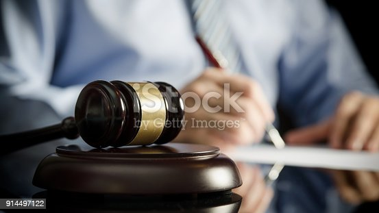 istock Lawyer in office with gavel, symbol of justice 914497122
