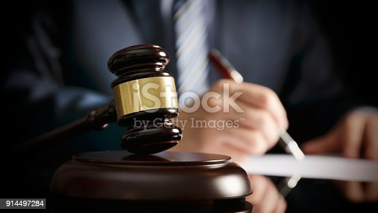 istock Lawyer in office with gavel, symbol of justice 914497284