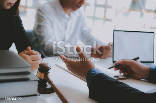 1045876492istockphoto lawyer insurance broker consulting giving legal advice to couple customer about buying renting house. financial advisor with mortgage loan investment contract. realtor selling real estate 1156263120