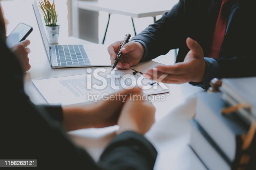 1045876492 istock photo lawyer insurance broker consulting giving legal advice to couple customer about buying renting house. financial advisor with mortgage loan investment contract. realtor selling real estate 1156263121
