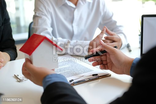 1045876492istockphoto lawyer insurance broker consulting giving legal advice to couple customer about buying renting house. financial advisor with mortgage loan investment contract. realtor selling real estate 1156263124