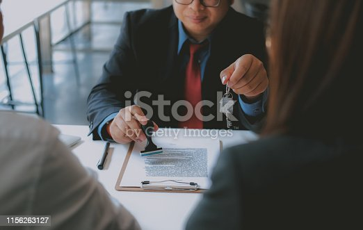 1045876492 istock photo lawyer insurance broker consulting giving legal advice to couple customer about buying renting house. financial advisor with mortgage loan investment contract. realtor selling real estate 1156263127