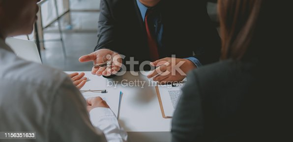 1045876492 istock photo lawyer insurance broker consulting giving legal advice to couple customer about buying renting house. financial advisor with mortgage loan investment contract. realtor selling real estate 1156351633