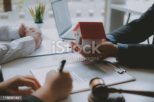 1045876492 istock photo lawyer insurance broker consulting giving legal advice to couple customer about buying renting house. financial advisor with mortgage loan investment contract. realtor selling real estate 1156351641