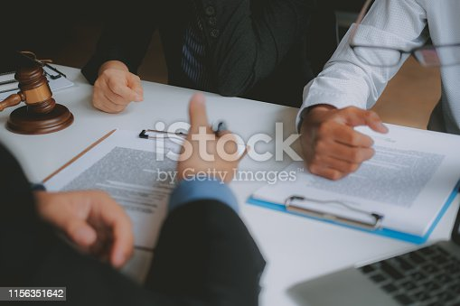 1045876492istockphoto lawyer insurance broker consulting giving legal advice to couple customer about buying renting house. financial advisor with mortgage loan investment contract. realtor selling real estate 1156351642