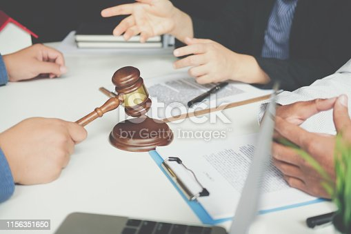 1045876492istockphoto lawyer insurance broker consulting giving legal advice to couple customer about buying renting house. financial advisor with mortgage loan investment contract. realtor selling real estate 1156351650