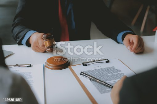 1045876492 istock photo lawyer insurance broker consulting giving legal advice to couple customer about buying renting house. financial advisor with mortgage loan investment contract. realtor selling real estate 1156351652
