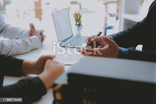689401592 istock photo lawyer insurance broker consulting giving legal advice to couple customer about buying renting house. financial advisor with mortgage loan investment contract. realtor selling real estate 1156574440