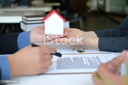 1045876492istockphoto lawyer insurance broker consulting giving legal advice to couple customer about buying renting house. financial advisor with mortgage loan investment contract. realtor selling real estate 1156574445