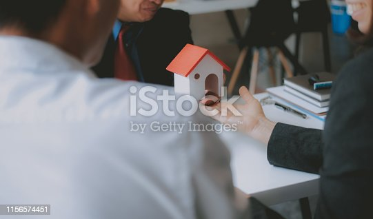 1045876492 istock photo lawyer insurance broker consulting giving legal advice to couple customer about buying renting house. financial advisor with mortgage loan investment contract. realtor selling real estate 1156574451