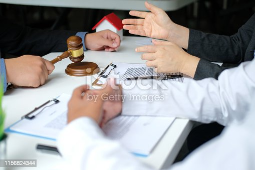 1045876492 istock photo lawyer insurance broker consulting giving legal advice to couple customer about buying renting house. financial advisor with mortgage loan investment contract. realtor selling real estate 1156824344