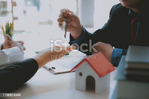 1045876492 istock photo lawyer insurance broker consulting giving legal advice to couple customer about buying renting house. financial advisor with mortgage loan investment contract. realtor selling real estate 1156824345