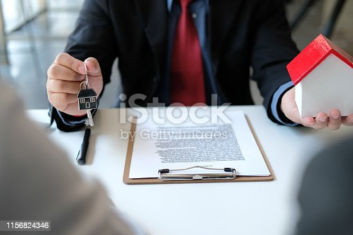 1045876492 istock photo lawyer insurance broker consulting giving legal advice to couple customer about buying renting house. financial advisor with mortgage loan investment contract. realtor selling real estate 1156824346