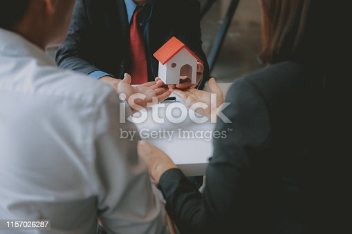 1045876492istockphoto lawyer insurance broker consulting giving legal advice to couple customer about buying renting house. financial advisor with mortgage loan investment contract. realtor selling real estate 1157026287