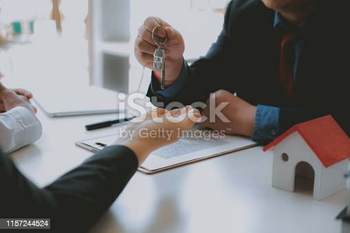 1045876492istockphoto lawyer insurance broker consulting giving legal advice to couple customer about buying renting house. financial advisor with mortgage loan investment contract. realtor selling real estate 1157244524