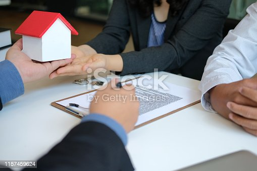 1045876492 istock photo lawyer insurance broker consulting giving legal advice to couple customer about buying renting house. financial advisor with mortgage loan investment contract. realtor selling real estate 1157459624