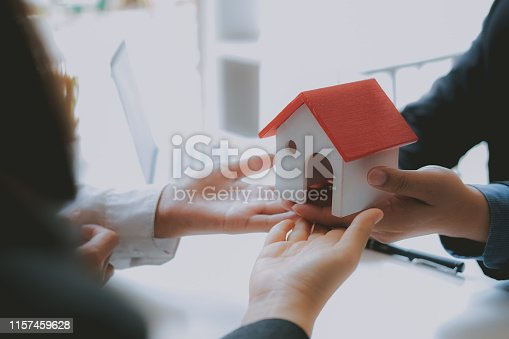 1045876492 istock photo lawyer insurance broker consulting giving legal advice to couple customer about buying renting house. financial advisor with mortgage loan investment contract. realtor selling real estate 1157459628