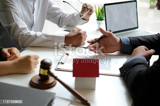 1045876492 istock photo lawyer insurance broker consulting giving legal advice to couple customer about buying renting house. financial advisor with mortgage loan investment contract. realtor selling real estate 1157459630
