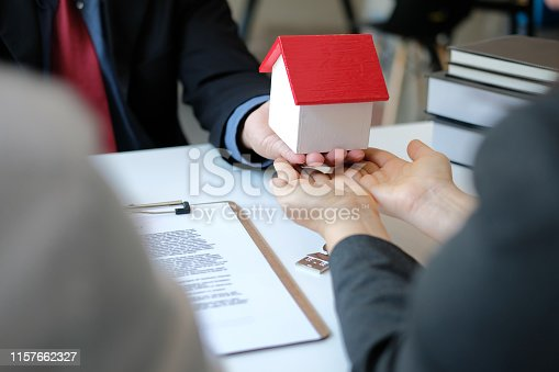 1045876492 istock photo lawyer insurance broker consulting giving legal advice to couple customer about buying renting house. financial advisor with mortgage loan investment contract. realtor selling real estate 1157662327