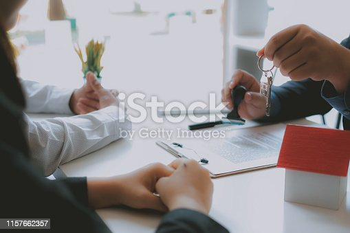 1045876492 istock photo lawyer insurance broker consulting giving legal advice to couple customer about buying renting house. financial advisor with mortgage loan investment contract. realtor selling real estate 1157662357