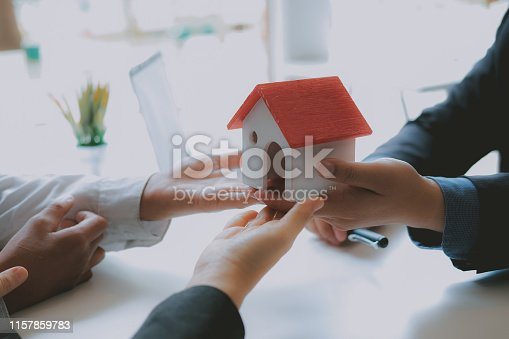 1045876492istockphoto lawyer insurance broker consulting giving legal advice to couple customer about buying renting house. financial advisor with mortgage loan investment contract. realtor selling real estate 1157859783
