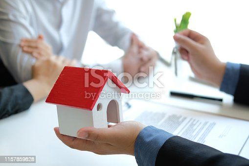 1045876492 istock photo lawyer insurance broker consulting giving legal advice to couple customer about buying renting house. financial advisor with mortgage loan investment contract. realtor selling real estate 1157859828