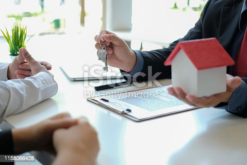 1045876492 istock photo lawyer insurance broker consulting giving legal advice to couple customer about buying renting house. financial advisor with mortgage loan investment contract. realtor selling real estate 1158086428