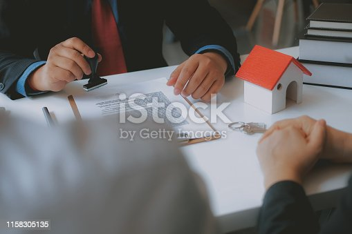 1045876492 istock photo lawyer insurance broker consulting giving legal advice to couple customer about buying renting house. financial advisor with mortgage loan investment contract. realtor selling real estate 1158305135