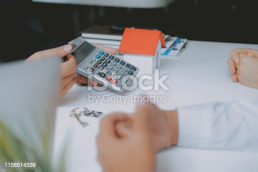 1045876492 istock photo lawyer insurance broker consulting giving legal advice to couple customer about buying renting house. financial advisor with mortgage loan investment contract. realtor selling real estate 1158514339