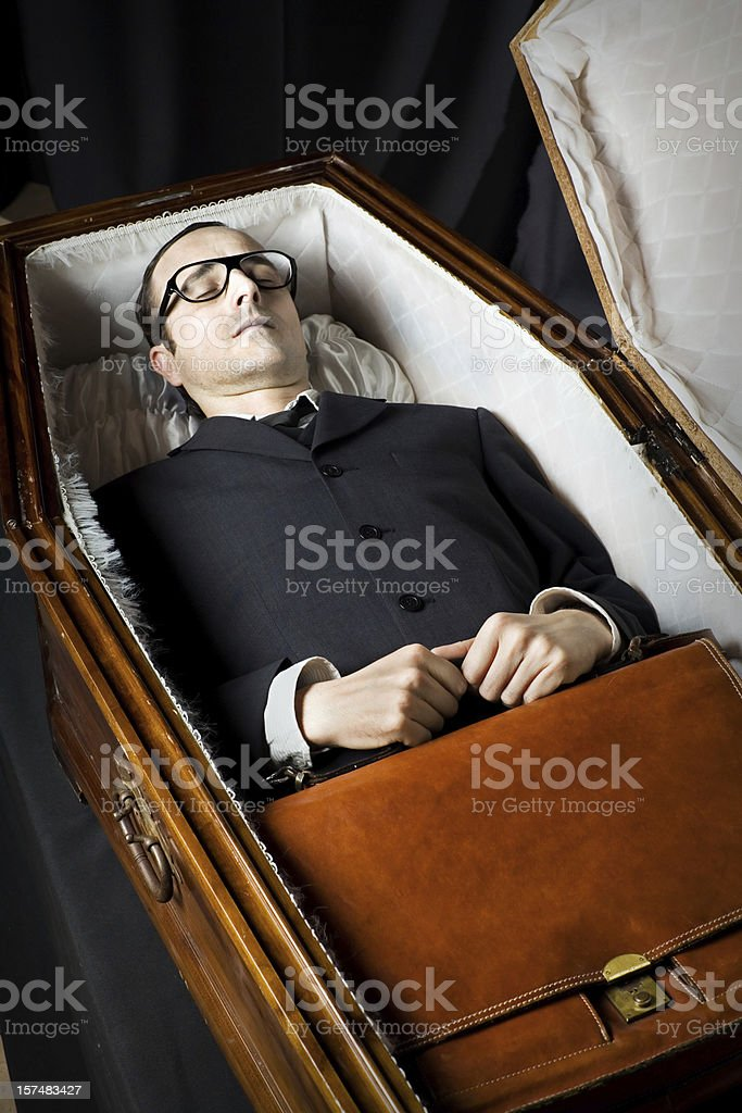 Lawyer Lying In Coffin stock photo