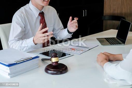 istock Lawyer man consultation and explain the prosecution in the Office. 1130459809