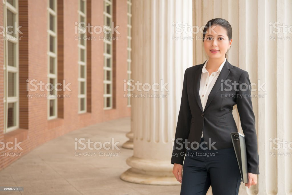 lawyer manager standing in justice court outdoor stock photo