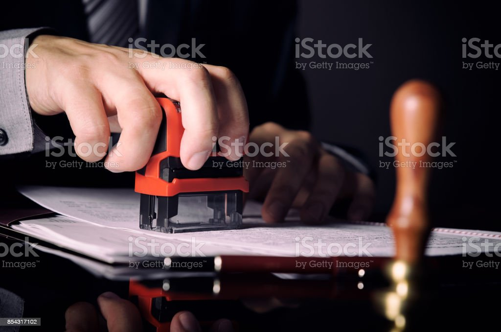 Lawyer or attorney working in office with automatic stamp stock photo