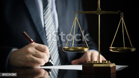 istock Lawyer or attorney works in his office 905234380