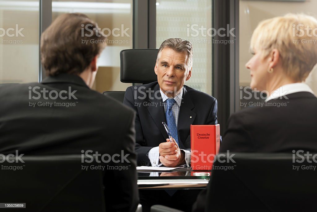 Lawyer or notary with clients in his office royalty-free stock photo