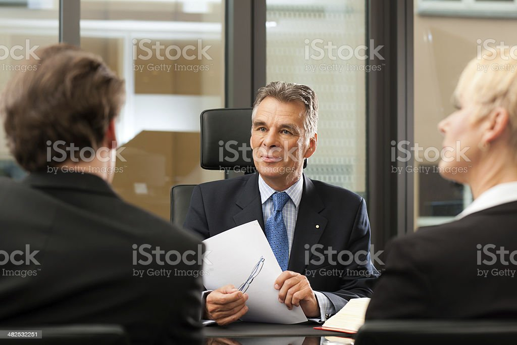 Lawyer or notary with clients in his office stock photo